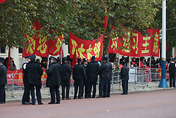 © Licensed to London News Pictures. 20/10/2015. London, UK. Police watch supporters of Chinese President Xi Jinping in The Mall ahead of a four day State Visit to the United Kingdom. Photo credit: Peter Macdiarmid/LNP