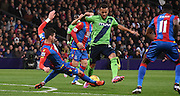 Joel Ward with the slide challenge, ending Ryan Bertrand's attack during the Barclays Premier League match between Crystal Palace and Southampton at Selhurst Park, London, England on 12 December 2015. Photo by Michael Hulf.