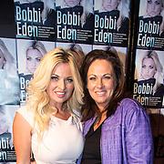 NLD/Amsterdam/20140325 - Boekpresentatie Bobbi Eden, Bobbi en haar zus