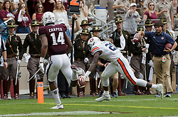 Auburn running back Kerryon Johnson (21) holds the ball out over the goal line for a touchdown against Texas A&M during the second quarter of an NCAA college football game on Saturday, Nov. 4, 2017, in College Station, Texas. (AP Photo/Sam Craft)