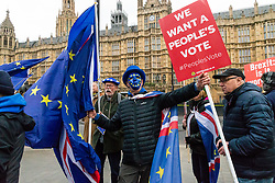 Remain campaigner Steve Bray wears an EU mask as Pro-Brexit campaigner James Goddard once again visits and attempts to disrupt Bray's SODEM anti-Brexit protest the day after he was seen harassing former cabinet minister Anna Soubry. Westminster, London, December 20 2018.