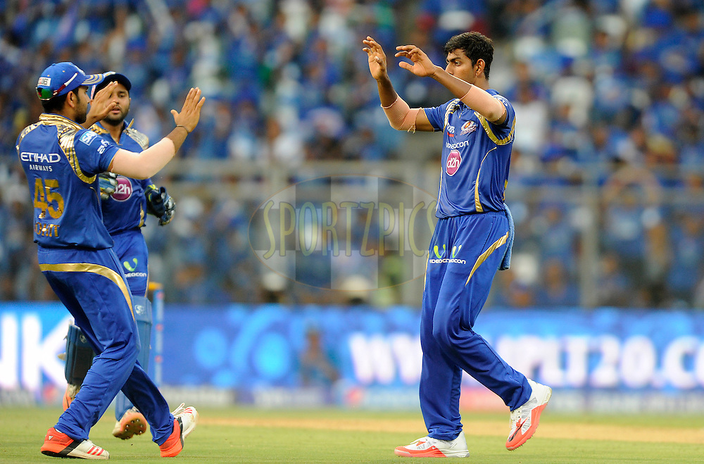 J Suchith of Mumbai Indians celebrates the wicket of Naman Ojha of Sunrisers Hyderabad during match 23 of the Pepsi IPL 2015 (Indian Premier League) between The Mumbai Indians and The Sunrisers Hyferabad held at the Wankhede Stadium in Mumbai India on the 25th April 2015.<br /> <br /> Photo by:  Pal Pillai / SPORTZPICS / IPL