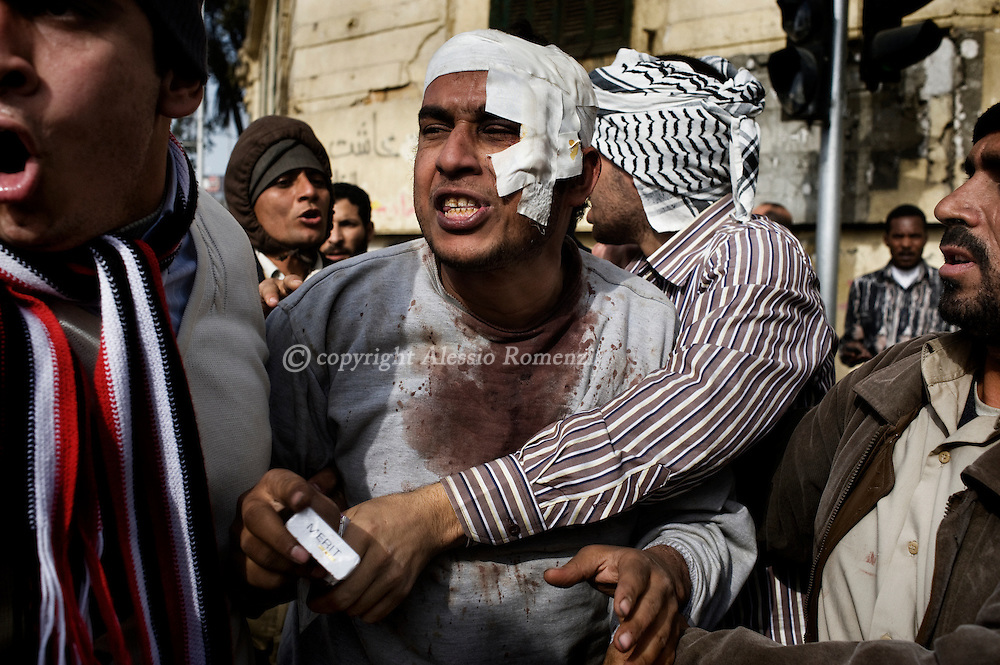 A pro-Mubarak demostrator captured by anti-government protesters in Tahrir square in Cairo on February 3, 2010. © ALESSIO ROMENZI