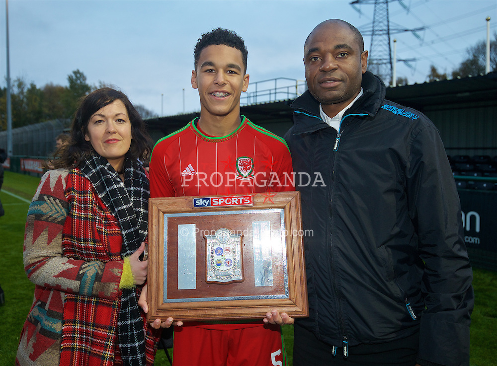 NEWPORT, WALES - Thursday, November 5, 2015: Wales' Benjamin Cabango and his parents celebrate with the Victory Shield following a 3-1 win over Northern Ireland during the Under-16's Victory Shield International match at Dragon Park. (Pic by David Rawcliffe/Propaganda)