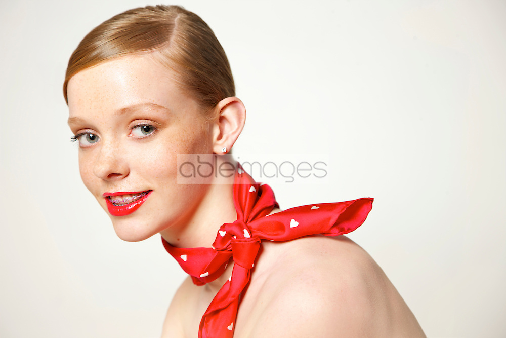 Young Woman with Dental Braces and Red Scarf around Neck