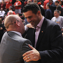 Mar 7, 2009; Piscataway, NJ, USA; New Rutgers athletic director Tim Pernetti congratulates coach Fred Hill on his team's 45-42 victory over South Florida on senior day at the Louis Brown Athletic Center..