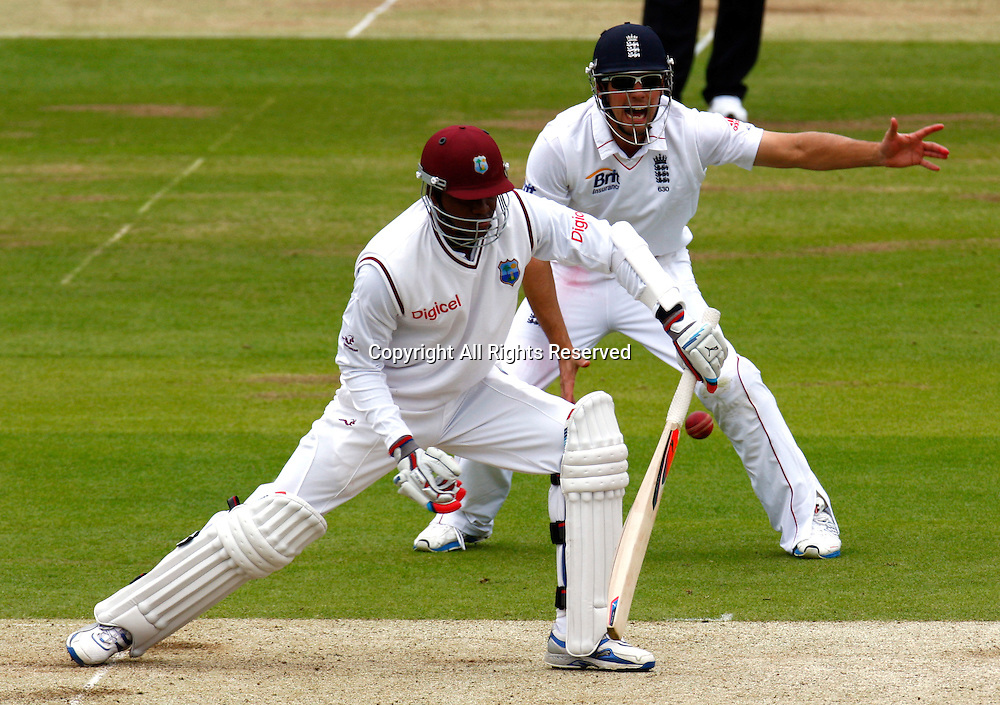 17.05.12 Lords, London. Marlon Samuels of West Indies and Alastair Cook of England during the Investec First Test (1st Day of 5) between England and West Indies.