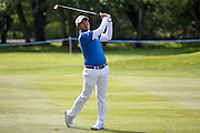 Korean golf professional Byeong Hung An with his approach shot during the BMW PGA Championship at the Wentworth Club, Virginia Water, United Kingdom on 26 May 2016. Photo by Simon Davies.