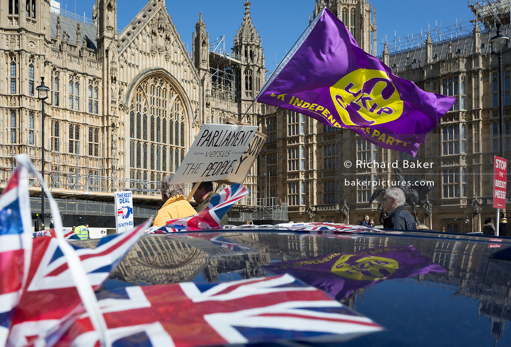 On the day that Prime Minister Theresa May returns to Brussels to negotiate an expected Brexit delay, a UKIP Leaver's flag outside parliament in Westminster, in London, England.