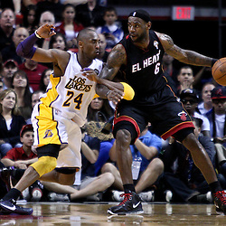 March 10, 2011; Miami, FL, USA; Miami Heat small forward LeBron James (6) is guarded by Los Angeles Lakers shooting guard Kobe Bryant (24) during the first quarter at the American Airlines Arena.  Mandatory Credit: Derick E. Hingle