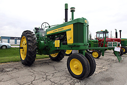 04 May 2013:   Arranged to coincide and be a part of the Red Corridor Route 66 festival, the village of Lexington hosts an antique tractor show.  Roger Whaley is the chairman of the organizing committee. 1957 Model 620 Row Crop John Deere.