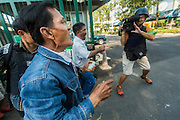 "01 FEBRUARY 2014 - BANGKOK, THAILAND: Thai voters break into the polling place in the Din Daeng district offices in Bangkok. They were not able to vote because the polling place had been declared closed. Thais went to the polls in a ""snap election"" Sunday called in December after Prime Minister Yingluck Shinawatra dissolved the parliament in the face of large anti-government protests in Bangkok. The anti-government opposition, led by the People's Democratic Reform Committee (PDRC), called for a boycott of the election and threatened to disrupt voting. Many polling places in Bangkok were closed by protestors who blocked access to the polls or distribution of ballots. The result of the election are likely to be contested in the Thai Constitutional Court and may be invalidated because there won't be quorum in the Thai parliament.    PHOTO BY JACK KURTZ"