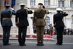 The Anzac Day tradition -WW1 memorial. Representative of the  Armed forces and ex-service organisations salute during the ANZAC day at The Centotaph in a service of remembrance. Whitehall, London, United Kingdom. Friday, 25th April 2014. Picture by Daniel Leal-Olivas / i-Images