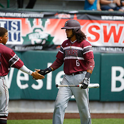 Texas Southern infielder Jose Camacho (6) celebrates with teammate Horace LeBlanc III (14) after a scoring on a single by catcher Blake Hicks (not pictured) during the top of the first inning of the SWAC baseball championship final in New Orleans, La. Sunday, May 21, 2017.
