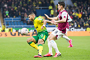 Norwich City midfielder Onel Hernández (11) tackled by   the opponent during the The FA Cup match between Burnley and Norwich City at Turf Moor, Burnley, England on 25 January 2020.