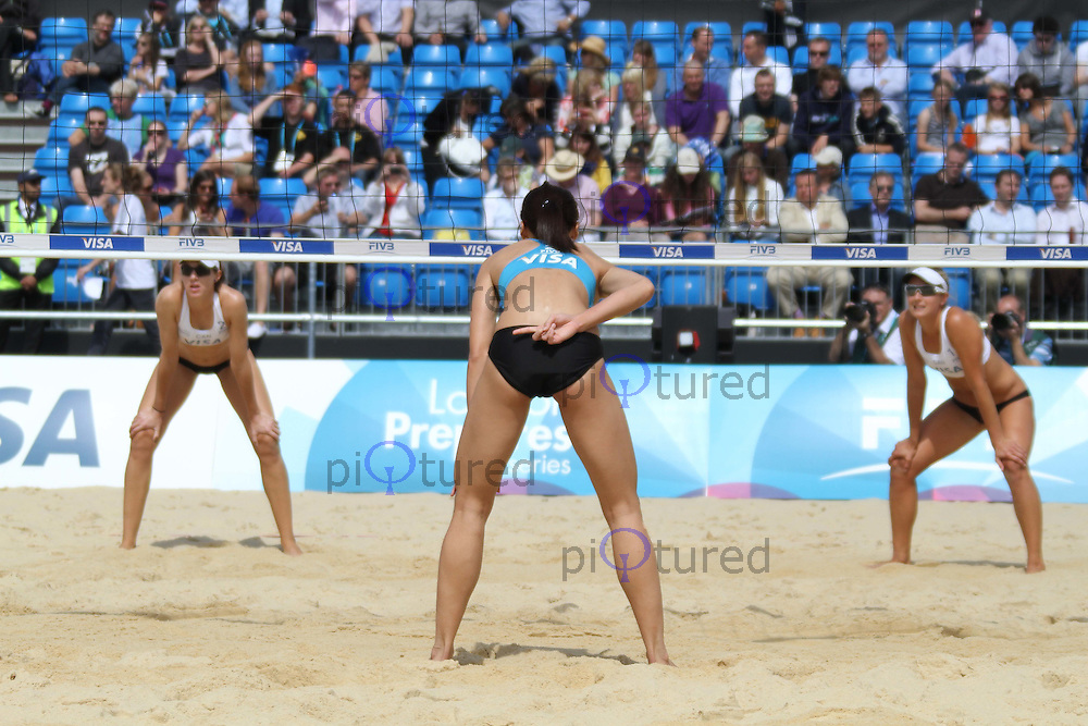 Heather Bansley & Elizabeth Maloney (Canada); Beh Shun Thing & Luk Teck Hua (Malaysia) Visa FIVB Beach Volleyball International - London 2012 test event - Horse Guards Parade, Horse Guards Parade, London, UK, 09 August 2011:  Contact: Rich@Piqtured.com +44(0)7941 079620 (Picture by Richard Goldschmidt)