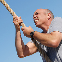 "Santa Monica Police Chief Timothy J. Jackman climbs a 15-foot rope at Santa Monica Muscle Beach during CrossFit's ""Hero Workout,"" in honor former SMPD Officer and Marine Rick Crocker on Thursday, May 26, 2011. Crocker was killed six years ago today while serving in Iraq. The ""Hero Workout of the Day"" is named after those who have given their lives in the line of duty."