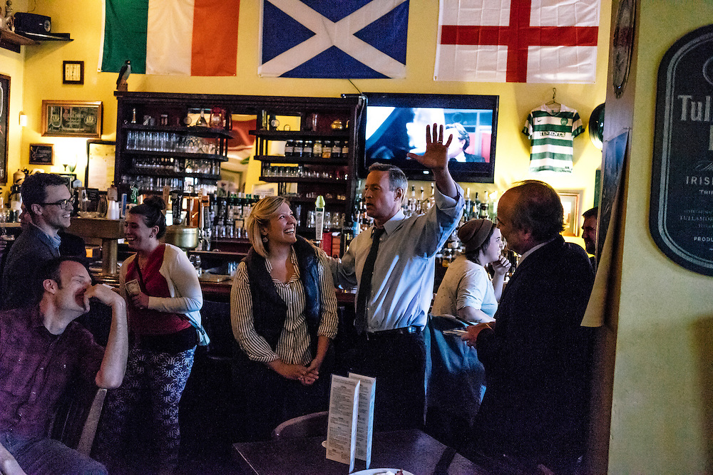 Former Maryland Governor Martin O'Malley greets a group of teachers celebrating a birthday at Liam Flynn's Ale House in Baltimore on Thursday, May 21, 2015. O'Malley is considering a run for President of the United States.