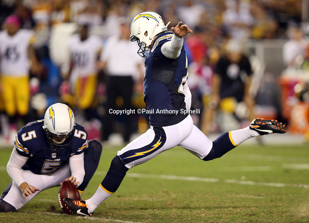 San Diego Chargers punter Mike Scifres (5) holds while San Diego Chargers kicker Josh Lambo (2) kicks a 40 yard fourth quarter field goal that ties the score at 10-10 during the 2015 NFL week 5 regular season football game against the Pittsburgh Steelers on Monday, Oct. 12, 2015 in San Diego. The Steelers won the game 24-20. (©Paul Anthony Spinelli)
