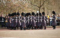 The guards march from St. James Palace to Buckingham Palace during Changing of the Guard, London, England.
