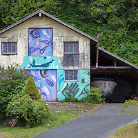 Buildings decorated with traditional First Nation mural artwork in the tiny village of Alert Bay, Cormorant Island, British Columbia, Canada.