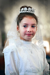 12 May 2013. New Orleans, Louisiana,  USA. .Sarah Christopher at her first Communion at Mater Dolorosa Church..Photo; Charlie Varley.