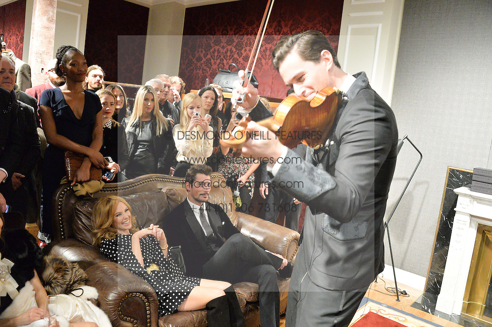 KYLIE MINOGUE and DAVID GANDY watch English contemporary classical violinist CHARLIE SIEM at the Dolce & Gabbana London Collections: Mens Event 2014 held at Dolce & Gabbana, 53-55 New Bond Street, London on 5th January 2014.