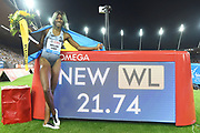 Shaunae Miller-Uibo (BAH) poses with the scoreboard after winning the women's 200m in 21.74 in the IAAF Diamond League final during the Weltkasse Zurich at Letzigrund Stadium, Thursday, Aug. 29, 2019, in Zurich, Switzerland. (Jiro Mochizuki/Image of Sport)