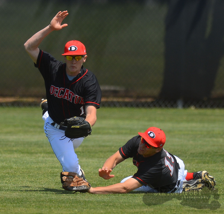 Gary Cosby Jr./Decatur Daily   The Decatur Red Raiders lost the deciding game of their state playoff series with Sparkman Saturday at Decatur High.  Center fielder Matthew Papich collides with right fielder Quintin Dupper as Dupper dives and catches a fly ball for an out.
