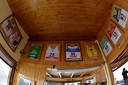 Signed bib 86 from the 2014 IPC Alpine Skiing World Cup right next to bib 28 from the 1992 Albertville Winter Paralymic Games - we're in good company on this wall at 2018 World Para Alpine Skiing World Cup, Tignes, France