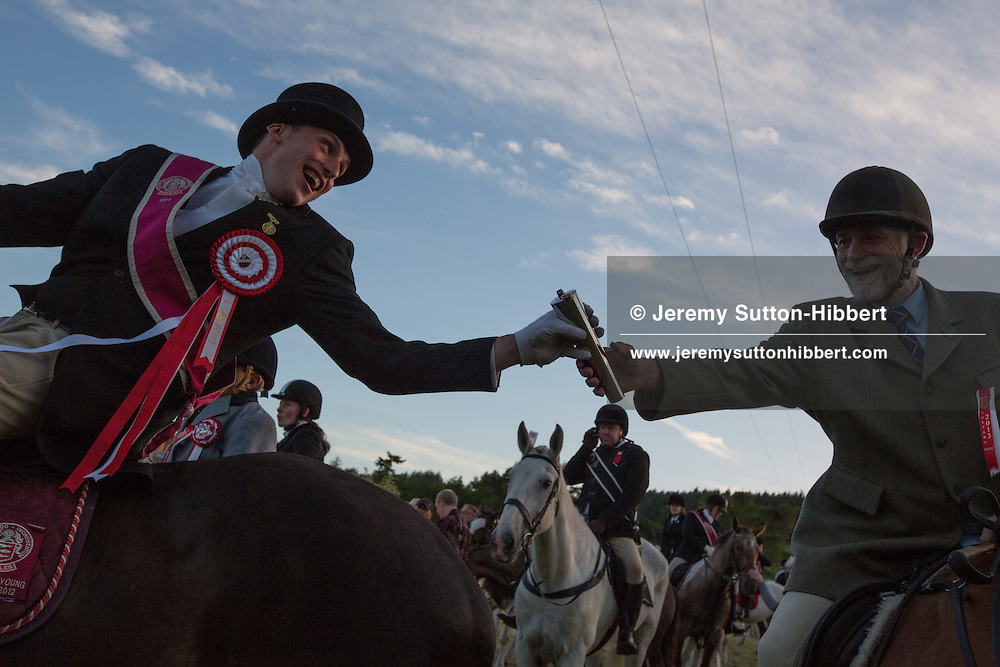 Horse racing, including the Beltane Bell race, on the golf course, at The Peebles Beltane Festival, including their Common Riding of the Marches, with Cornet Daniel Williamson, and Cornets Elect Lass Susan Thomson, in Peebles, Scotland, Wednesday 19th June 2013. <br /> N55&deg;39.572'<br /> W3&deg;12.562'
