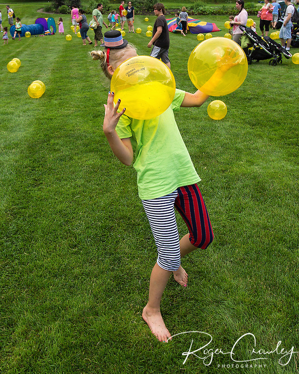 Lila Markow of Montpelier juggles on the State House Lawn. Energy Smart of Vermont provided hundreds of inflated yellow balls for kids to play with on the State House lawn during July 3rd celebrations in Montpelier.