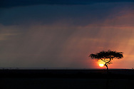 Sunset behind a rain cloud, Kenya conservation area north of Masai Mara.