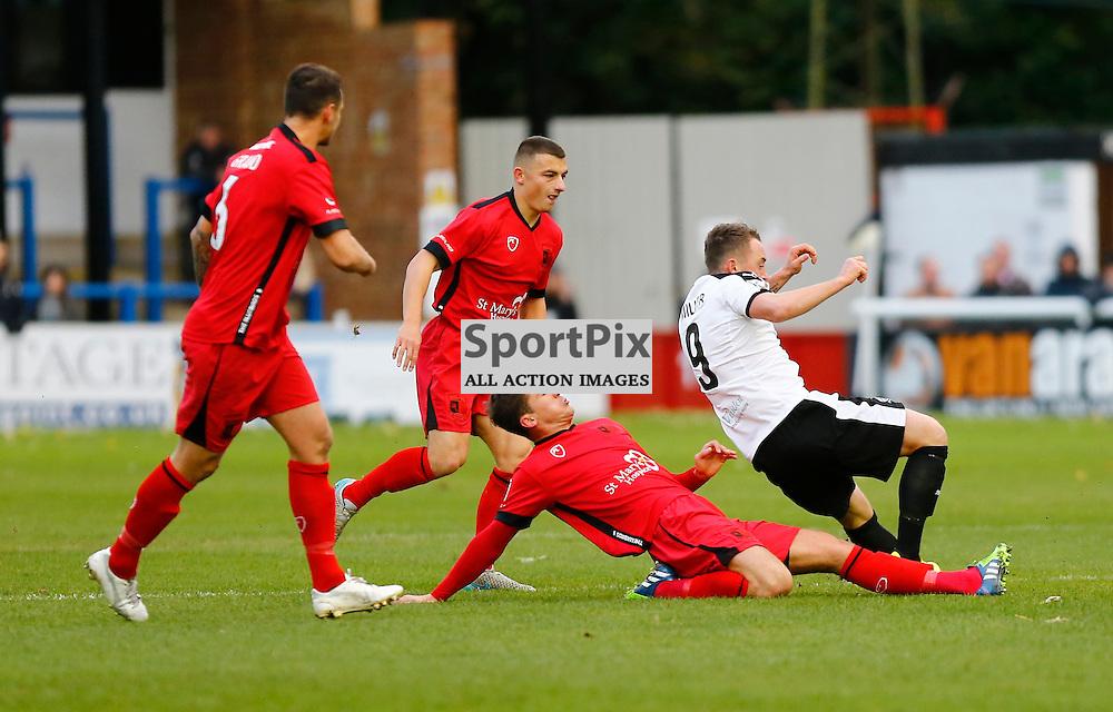 Dover's striker Ricky Miller (9) finds himself dispossed by Barrow's midfielder Paddy Lacey (4) Dover Athletic v Barrow. Vanarama National League. 10  November 2015. (c) Matt Bristow | SportPix.org.uk