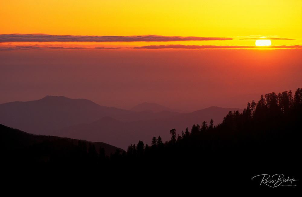 Hazy sunset over the foothills of the Sierra Nevada Mountains from Morro Rock, Sequoia National Park, California