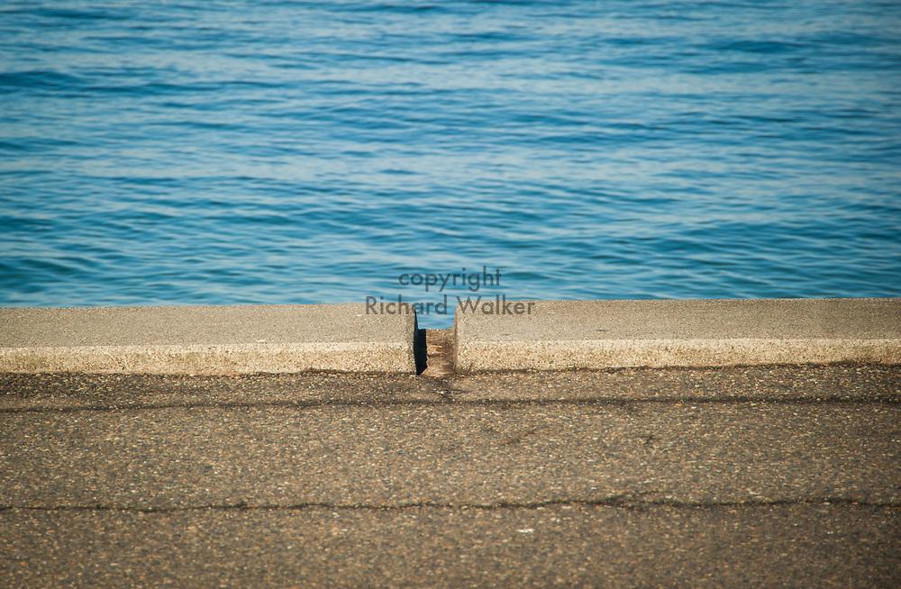 2017 NOVEMBER 06 - Water and asphalt, Alki Beach, Seattle, WA, USA. By Richard Walker