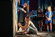 Sarah Terrell and Mindy Field work on their collaborative mural in the evening of August 11, 2016 during the Freak Alley Gallery sixth annual mural event in downtown Boise, Idaho.<br /> <br /> This was Sarah's sixth year of painting a mural in Freak Alley Gallery. This year's mural was a collaborative project between her and friend Mindy Field. Mindy wanted to do a anthropomorphic goat man and they decided a pirate would be fun. Mindy came up with the character and Sarah came up with the background that would work with it and they just went from there.<br /> <br /> Freak Alley Gallery's week long event provided an &quot;art-in-motion&quot; experience as it welcomed the public to watch artists work on their murals.