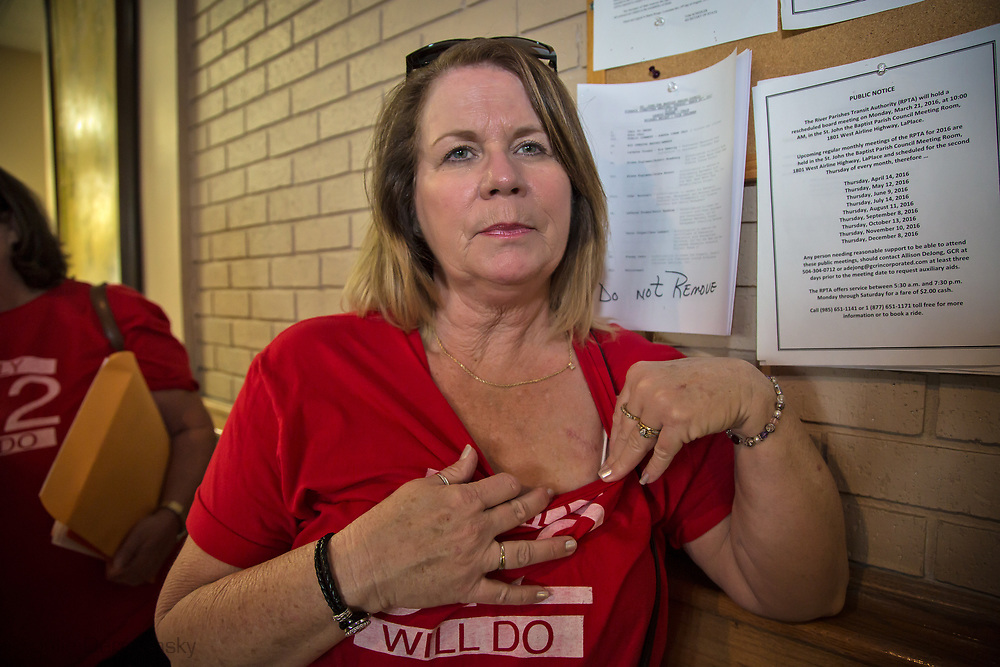 Kellie Tabb, homeowner in LaPlace, points out a scar from an operation she had to remove a carcinogenic tumor on her lung