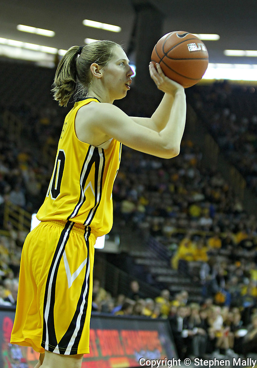 January 08 2010: Iowa forward Kelly Krei (20) puts up a shot during the first half of an NCAA womens college basketball game at Carver-Hawkeye Arena in Iowa City, Iowa on January 08, 2010. Iowa defeated Ohio State 89-76.