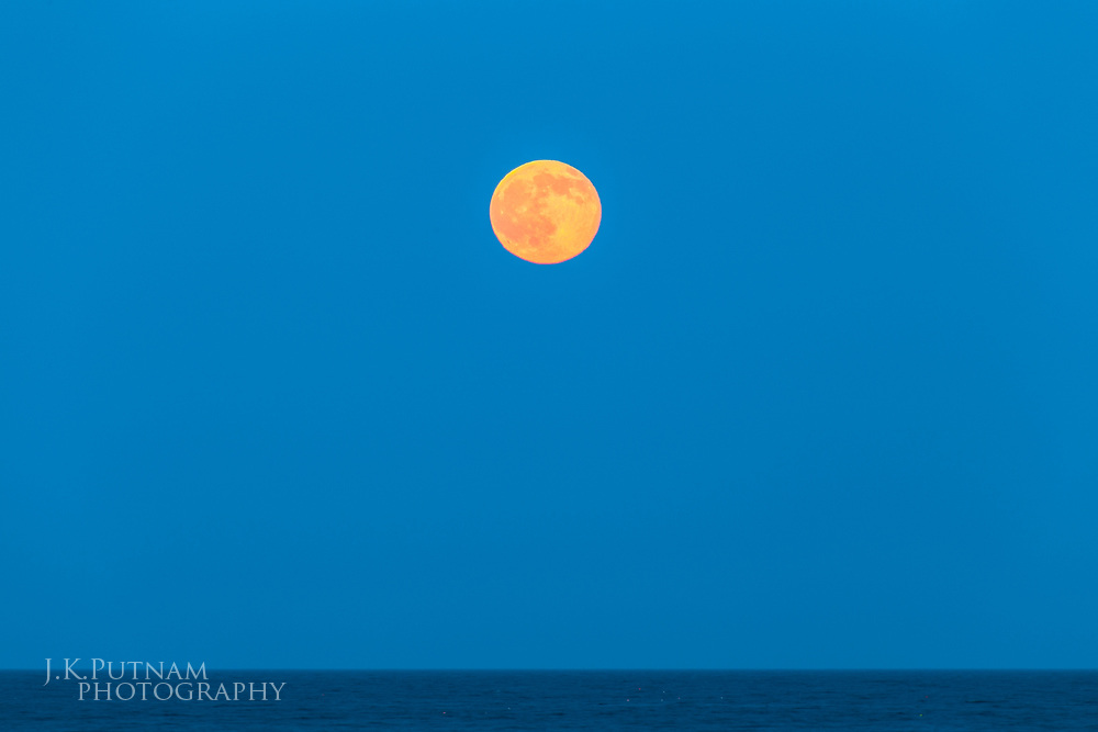 A full moon rises on the summer solstice in Acadia National Park, Mount Desert Island, Maine.