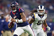 HOUSTON, TX - AUGUST 29:  Joe Webb III #5 of the Houston Texans runs the ball and is chased by Jeremiah Kolone #61 of the Los Angeles Rams during week four of the preseason at NRG Stadium on August 29, 2019 in Houston, Texas. The Rams defeated the Texans 22-10.   (Photo by Wesley Hitt/Getty Images) *** Local Caption *** Joe Webb III; Jeremiah Kolone