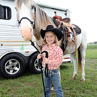 Sara Hendrix, age 5, from Kenansville, Florida prepares her horse Lilly prior to the 129th performance of the PRCA Silver Spurs Rodeo at the Silver Spurs Arena   on Friday, June 1, 2012 in Kissimmee, Florida. (AP Photo/Alex Menendez) Silver Spurs rodeo action in Kissimee, Florida. PRCA rodeo event in Florida. The 129th annual running of the cowboy event.