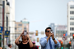 Pictures are taken as thousands of pedestrians, cyclist, skaters, joggers participate in the third annual Philly Free Streets event at a 4mi (6.4km) car-free section of North Broad Street, in Philadelphia, PA, on August 11, 2018.