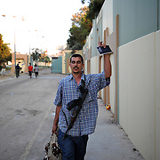 A rebel fighter gestures a victory signal during the take of Muammar Gaddafi's Bab Al Azizia compound in Tripoli.