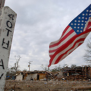 An American flag flies in the wind on the corner of a Gulfport, Mississippi street that was devastated by Hurricane Katrina six months earlier.