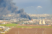 Firefighters extinguish Haifa Oil Refineries fire, after all-day blaze on December 25 2016 a fire broke out at the Israeli Oil refinery in Haifa bay. The fire overtook a benzene storage container at an Oil Refineries (Bazan) Ltd. facility – diminishing by early afternoon but soon intensifying once again.