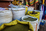 Incense is sold from sacks on a stall next to the Boudhanath stupa in Kathmandu, Nepal.
