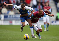 Photo: Paul Thomas.<br /> Wigan Athletic v Aston Villa. The Barclays Premiership. 19/11/2006.<br /> <br /> Gabriel Agbonlahor of Aston Villa (Maroon) tries to get past David Wright (Blue).