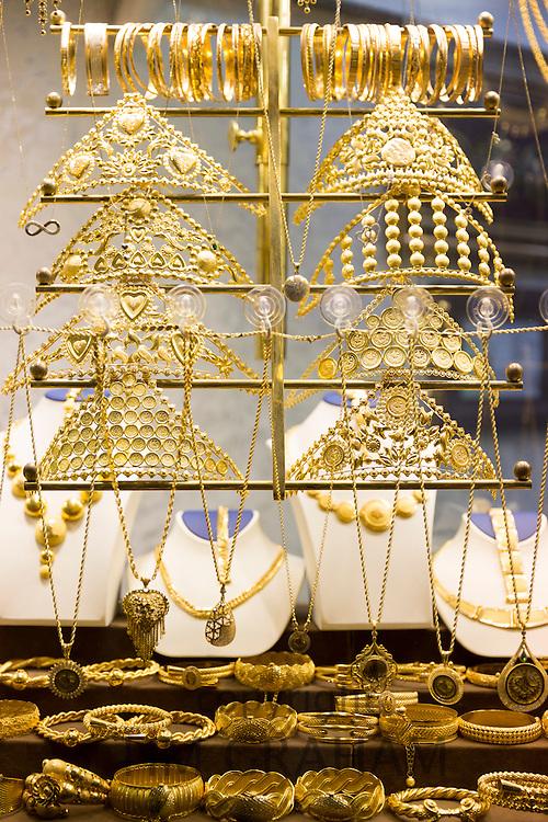 Gold jewelry headress necklaces and bracelets in goldsmiths shop, The Grand Bazaar, Kapalicarsi market, Beyazi, Istanbul, Turkey