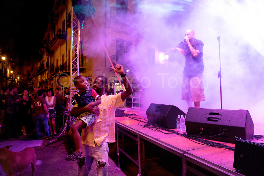 """The historical center of Palermo, especially in the """"mandate"""" of Ballarò, is definitely a multiethnic area, Christian """"Picciotto"""" Paterniti & The Gold Diggers, sings in sicilian dialect using  rap rhythms in the Piazza Professa at the final festival of Mediterranean Anti-racist, a multiethnic football champinship"""